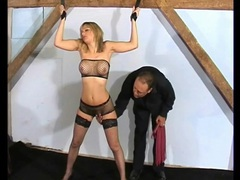 Flogging a fake tits girl in bondage movies at find-best-mature.com