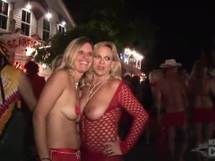Scantily clad costume girls at street party videos