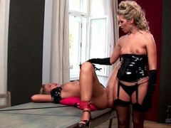 Lesbian in black lingerie wears strapon for fun movies