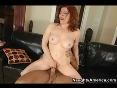 Redhead milf with fake tits and hairy cunt rides videos