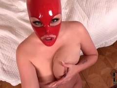 Babe in red latex mask gives pov handjob videos