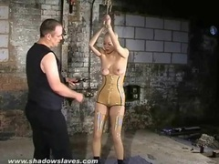 Girl in tight latex suffers through tit torture movies at find-best-lingerie.com
