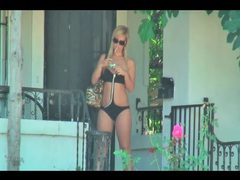 Chick walks in her swimsuit and smokes outdoors videos