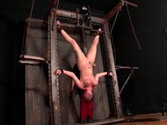 Redhead hangs upside down in sexy bondage videos