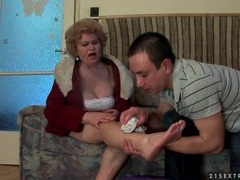 He helps an injured mature woman and licks her feet videos