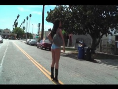 Girl goes for a walk in bikini and boots videos