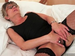 Solo old lady in glasses and fishnets masturbates movies at lingerie-mania.com