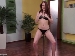 Redhead in short skirt works the pole movies at kilopills.com
