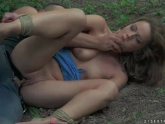 Shaved cunt of bondage girl used in the woods videos