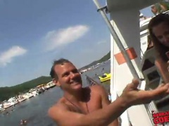 Topless girls model for guys on the boat videos