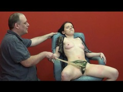 Her eyes are closed in pain during bdsm video movies at kilotop.com