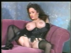 Black lingerie and satin gloves on this busty solo girl videos