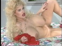 Red lipstick and fingernails on this fake titty blonde babe videos
