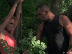 He fondles tied up slave girl in the woods clip