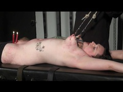 Titties tied up and candles dripping on her videos