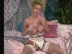 Fake tits girl masturbates pussy in vintage porn videos