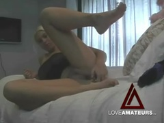 Hot and sexy blonde fucks pussy with a toy clip