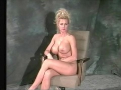 80s babe teases her big fake tits in close up movies at find-best-lingerie.com