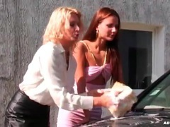 Girls in sexy outfits wash the car outdoors videos