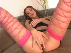 Sheer black lingerie and sexy pink fishnets on her videos