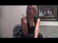 Girl in tights and a sexy top smokes a cigarette movies at lingerie-mania.com