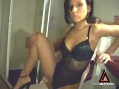 Beauty in black lingerie rubs pussy on camera videos
