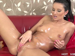 Oiled up nympho squirts all over the couch videos