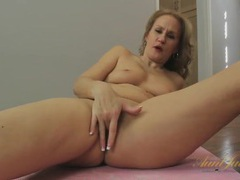 Mom on a yoga mat masturbating her hot cunt tubes