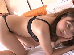 Asian rolls around in bed in her black lace lingerie movies at freekilomovies.com