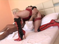 Corset and latex boots on his cocksucking slut movies at find-best-hardcore.com