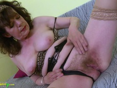 Granny dressed up in leopard print plays with her tits and cunt movies at find-best-lesbians.com