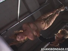 Asian bondage scene with rope suspension and forced orgasm tubes at thai.sgirls.net