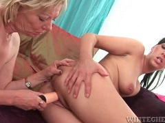 Mature lesbo fucks a toy into younger lover videos