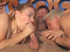 Busty milf and two guys in bisexual threesome clip