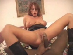 Hot redhead in black leather boots rides black cock movies at find-best-mature.com