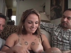 Nice tits and tattoos on a girl sucking two dicks videos
