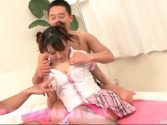 Pulling off her schoolgirl uniform and fingering her videos
