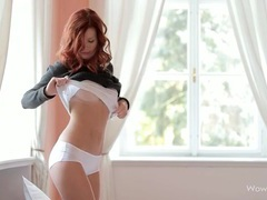 Young redhead looks smoking hot in a sweater videos