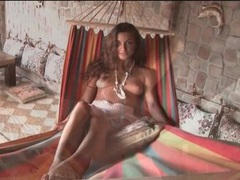 Girl in a skirt hangs out in her hammock videos