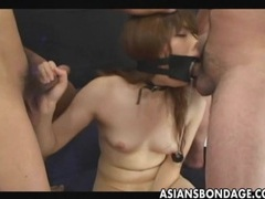Japanese sucks with a large open mouth gag tubes at japanese.sgirls.net