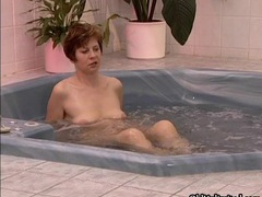 Nasty brunette mature slut gets horny in the jacuzzi movies at sgirls.net