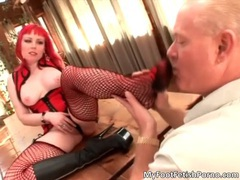 Sexy redhead babe gets her black boots adored for foot fetish scene videos