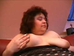 Fat mature strips and fucks toy into her vagina videos