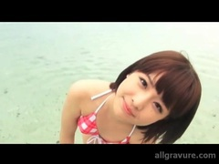 Bikini on a cute japanese girl in the ocean movies