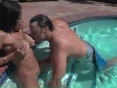 He sucks on the tits of the busty girl in the pool videos