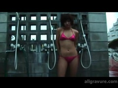 Lithe japanese body in a shiny pink bikini videos