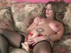 Chubby mom in lingerie has fun with toy movies at sgirls.net