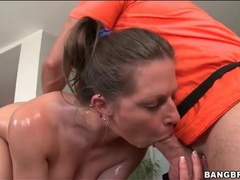 Masseur stuffs a toy in her oiled up cunt tubes