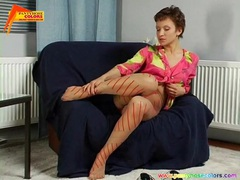 She fools around solo in her pretty pantyhose videos