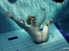 Blonde goes for a swim and strips videos